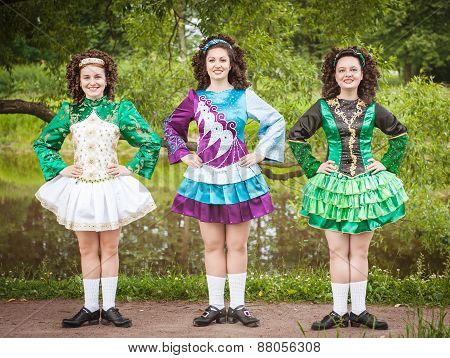 Three Young Beautiful Girls In Irish Dance Dress And Wig Posing