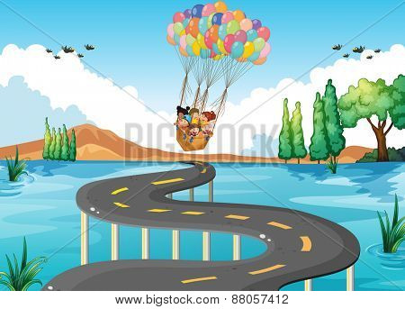 Children flying over the river and road