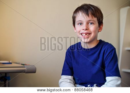 Portrait of little boy who lost his milk tooth