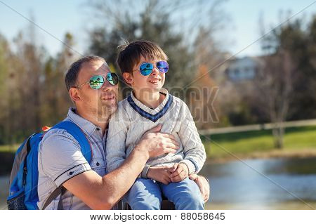 Happy father and his cute little son outdoors