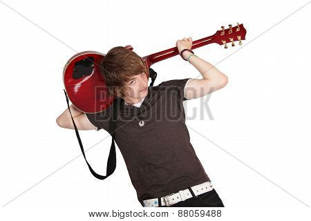 Teenager playing guitar behind his head