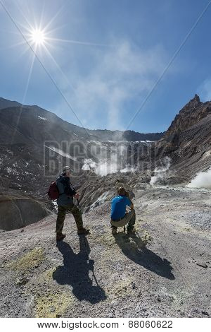 Tourists In Active Crater Mutnovsky Volcano On Kamchatka. Russia
