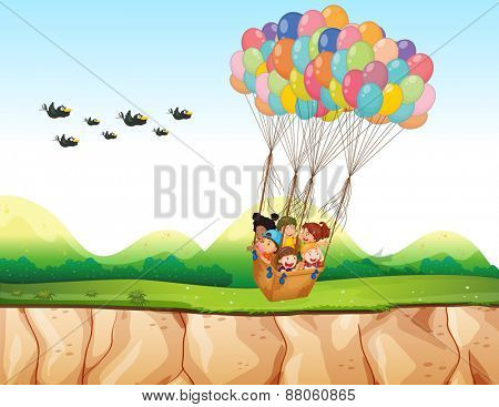 Children riding in a balloon over the cliff