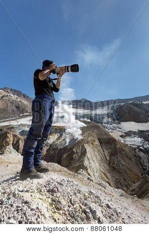 Photographer In The Crater Of Active Mutnovsky Volcano. Kamchatka