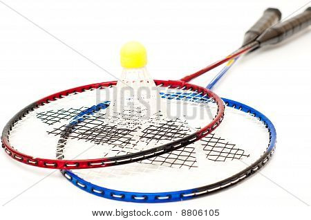 Badminton Rackets And Birdie On A White Background