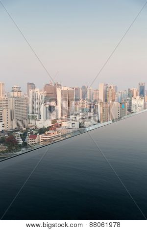 travel, vacation, tourism and luxury concept - beautiful view from infinity edge pool to bangkok city