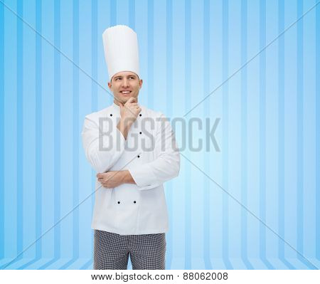 cooking, profession, inspiration and people concept - happy male chef cook thinking over blue striped background