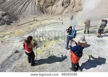 Group Photographers In The Crater Of Active Mutnovsky Volcano. Kamchatka
