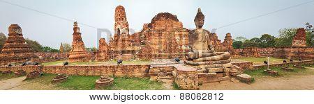 Buddha statue in Wat Mahatat. Ayutthaya historical park. Panorama