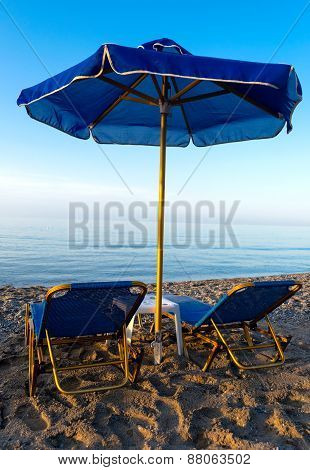 Parasols And Chais-longue On The Beach
