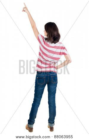 Back view of  pointing woman. beautiful brunette  girl in yellow striped t-shirt. Rear view people collection.  backside view of person.  Isolated over white background.