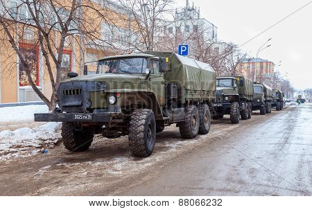 Green Russian Military Truck Ural 4320 Worth In The Row On A City Street