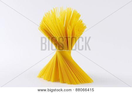 bundle of uncooked spaghetti on white background