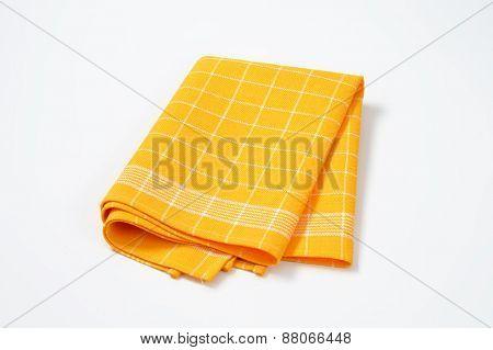 yellow checkered dishtowel on white background