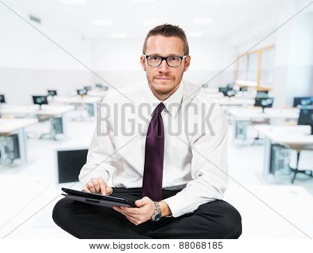 sit businessman with tablet and school background