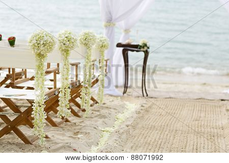 white flower themed wedding setup on beach