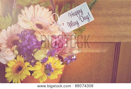 Happy May Day Gift Of Flowers On Door.