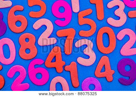 Mixed Coloured Numbers On A Blue Background.