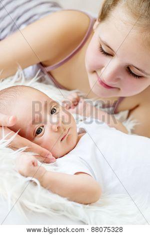Cute Little Sister Looks At Newborn