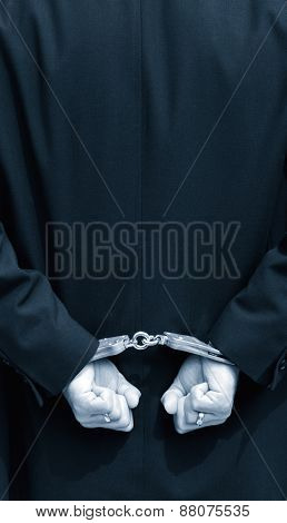 Hands in handcuffs behind back