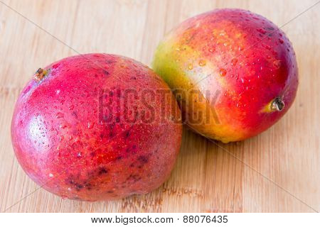 Tropical Fruits: Beautiful Mangos In Wooden Board