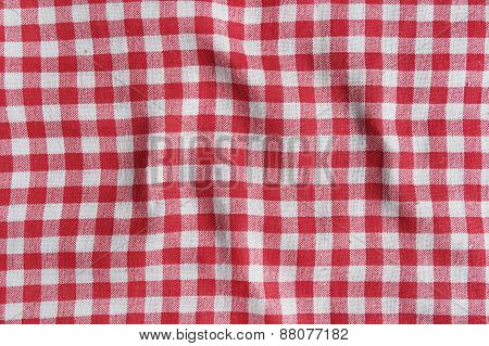 Red linen crumpled tablecloth texture.