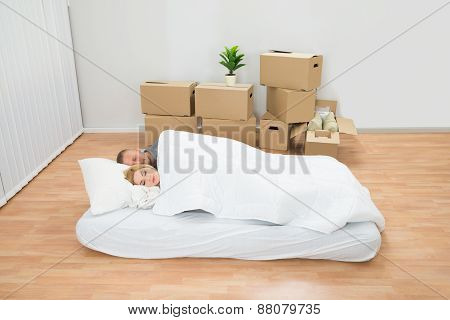 Young Couple Sleeping On Mattress