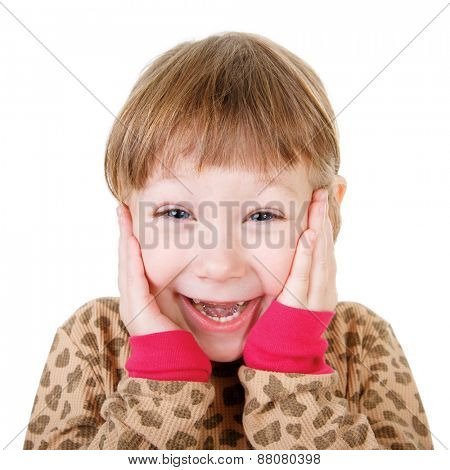 Cute little girl in shirt holding hands to face in surprise isolated on white background