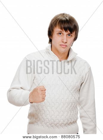 Exited young man kicks air clenched fists arm