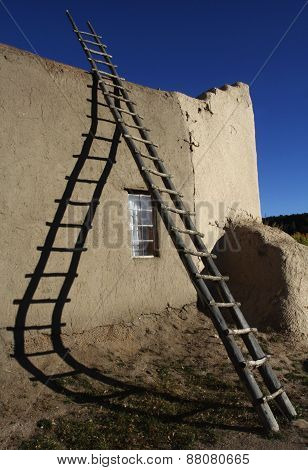 Ladder Casting Shadow On Wall Of St. Lawrence Church, Picuris Pueblo, New Mexico
