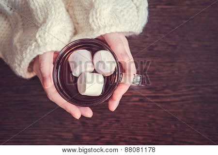 Woman holding cup of cocoa