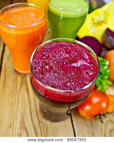 Juice beetroot and vegetable on board top