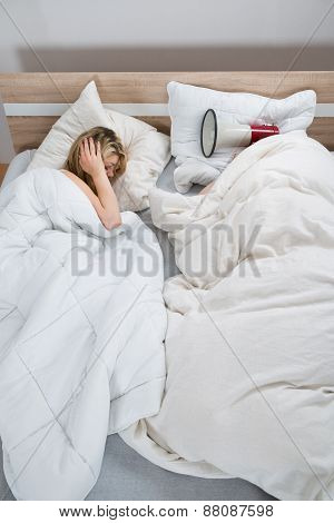Couple With Duvet In Bedroom