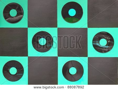 Green And Black Color Paint With Center Gramophone Record On Square Wood