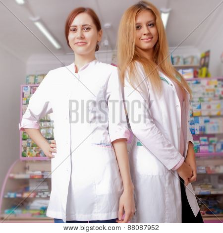 Two Young Female Doctor Smiling At Camera