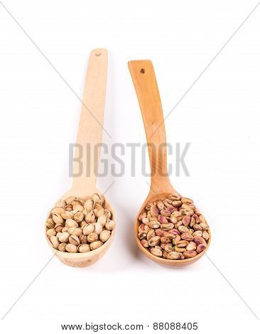 Collage of spoons with pistachios.