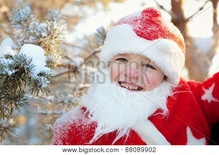 Portrait Of Boy Dressed As Santa