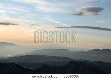 Sunset over the Julian Alps in the Triglav National Park in Slovenia pictured from Kredarica Peak (2,541 m).