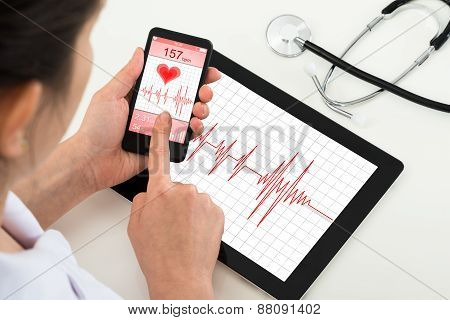 Doctor Looking At App For Health