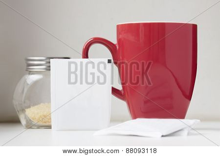 Tea Sachet With Teabag Red Teacup And Brown Sugar