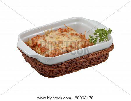 Delicious lasagna in wicker basket