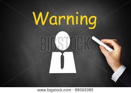 Hand Writing Warning On Black Chalkboard