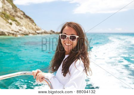 Portrait of a relaxing happy woman on the upper deck of a cruise ship