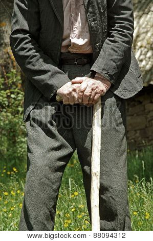 Elderly Man Lean On A Walking Cane Stick