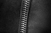 stock photo of zipper  - Black leather texture with metal zipper - JPG