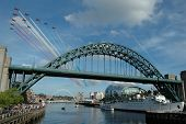 image of tyne  - bridge over river tyne with red arrows fly past.