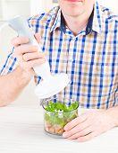 foto of blender  - Man using a hand blender to make a pate - JPG