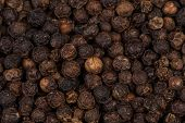 picture of peppercorns  - Black peppercorn spice background close up image - JPG