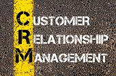 stock photo of customer relationship management  - Acronym CRM - Customer Relationship Management. Business Conceptual image with yellow paint line on the road over asphalt stone background. - JPG