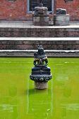 foto of hindu  - Hindu statue in a public fountain - JPG